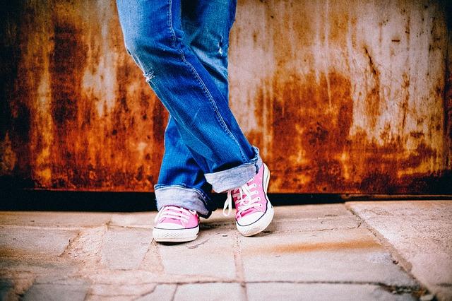 teenage girl feet sneakers jeans